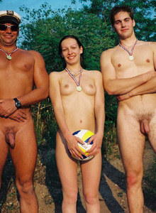 Two nudist boys and nudist girl with volleball ball