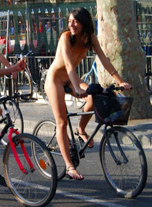 Nudists cycling at the street
