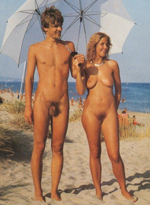 Nudists couple at the beach - very funny boy