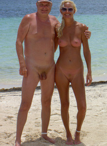 Nudist couple in micro string bikinis in the rocks
