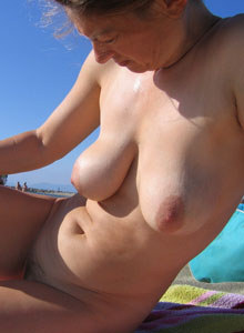 Horny mature busty gf Felicitas with big boobs and hairy pussy on the beach