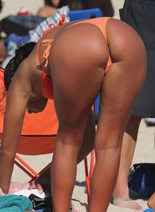 Tasty candid young asses in bikini on the beach