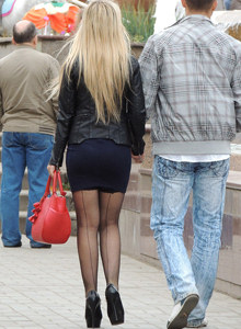 Beautiful candid girl in skirt and pantyhose