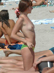 Beach full of topless nudists
