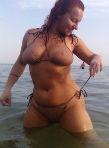 Exciting red head girl on the nudist beach