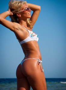 Exciting blonde gf in white bikini