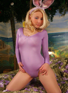 Blonde blue eyes busty teen Pattycake in shiny tight spandex with cameltoe