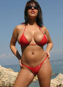 Busty Kora Kryk in red bikini with tits falling out the bikini