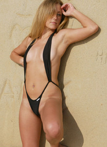 Exciting hot blonde Cindy on the beach in black micro bikini thong