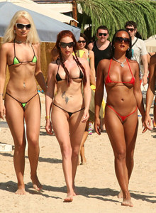 Four hotties visiting Sant Josep beach in micro bikinis
