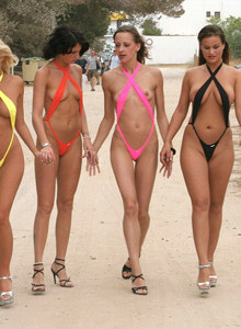 Walking and swimming in micro bikini thong in Ibiza