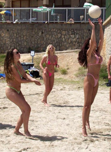 Playing volleyball on Ibiza beach in micro bikinis