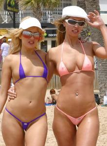 Denia girls walking in bikinis on the beach