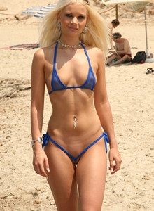 Blonde hottie Paris in at the beach in blue micro bikini showing sexy thong cameltoe