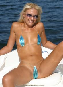Blonde Joy Jane on the boat in micro bikini showing stretching nipples