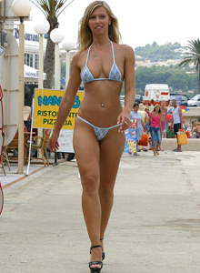 Perfect tall bikini cutie Isabel walking in sexy bikini on the street by the beach