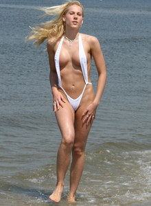 Blonde Celina in micro bikini thong at the sea side