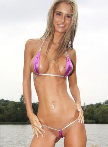 Busty hottie Nessa Devil in purple micro bikini near the river
