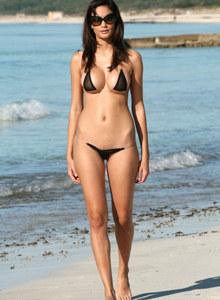 Asian chick Melody is on the beach showing her perfect body in black micro bikini