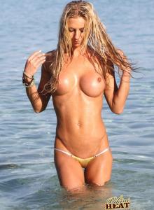 Sexy Jessy swimming topless in micro bikini
