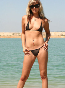 Tasty blonde Diana at the sea in black bikini