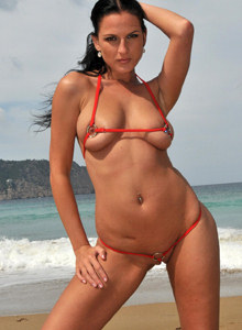 Perfect body brunette Walleria goes nude on the beach in red micro bikini with cameltoe