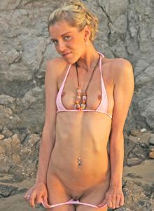 Puffy nipples Nikkita in sexy pink micro bikini goes topless at the rocks