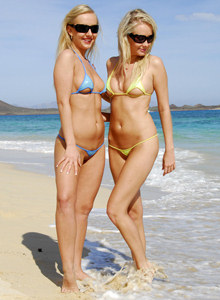 Lovely sexy blondes Deni and Lucynova on the beach in exciting micro bikinis