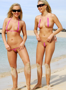 Exciting blondes Deni and Lucynova in pink micro bikinis look like twins on the beach