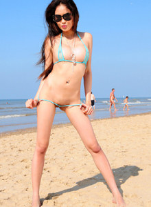 Playful asian hottie Davon Kim wears blue micro bikini with cameltoe on the beach