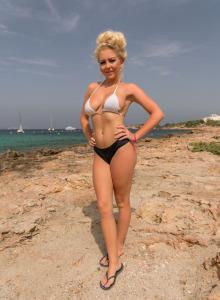 Busty hottie Beth is sexy on the pier in bikini