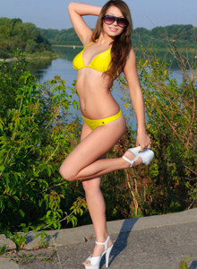 Yellow bikini Babe on the beach near the river