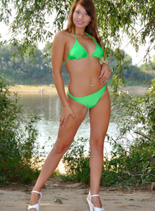Babe by the lake in green bikini and high heels
