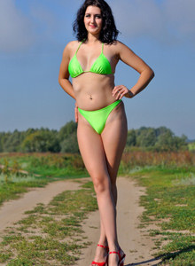 Sexy body Natasha in green bikini in the field