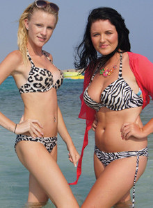 Young busty Caitlin and Amanda girls in zebra bikinis on the beach