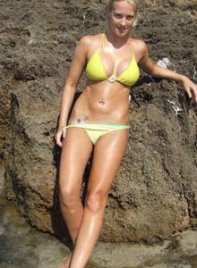 Amazing yellow bikini blonde Heather is topless at the beach rocks