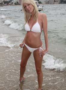 Perfect exciting blonde Marie at the seaside in white bikini