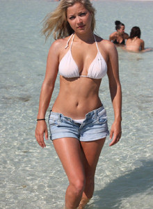 Busty blonde topless hottie Natalie wearing white bikini and jeans shorts in the sea and on the beach