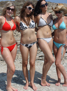 Watford girls with perfect bodies in bikinis on the beach and in the sea