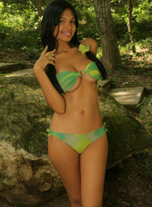 Busty brunette Karla is in the forest in green dress and green bikini