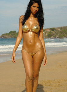 Busty beach chick Karla wearing shiny golden bikini