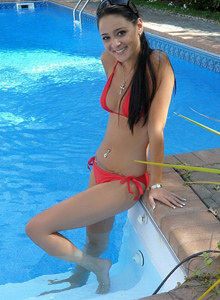 Hot brunette Annabelle is in the pool in red bikini