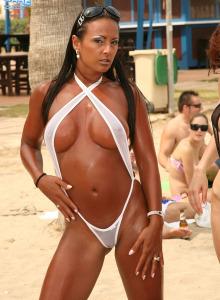 Four sexy cuties in micro bikini thongs on the Sant Josep beach